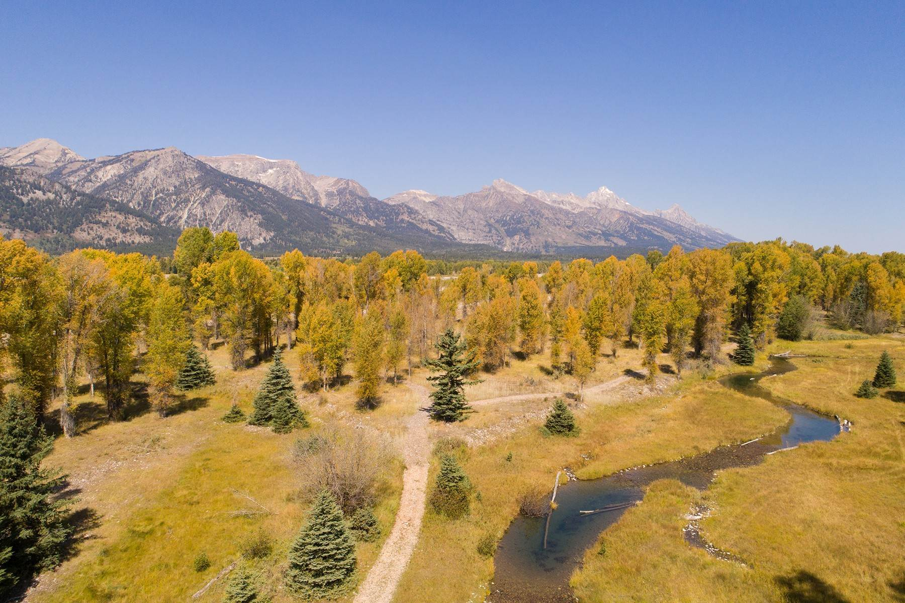 8. Single Family Homes for Sale at 7555 N Bar B Bar River Road Jackson, Wyoming 83001 United States